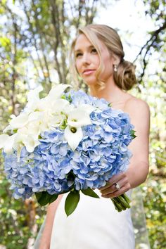 What if I carried blue hydrangeas and my maids carried soft pink flowers? This would be awesome if I wore soft pink and they wore blue!