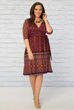 Our plus size Beguiling Border Wrap Dress has everything you want for a feminine look with a batik print and boho flair. Find this wardrobe must-have and more made in the USA inspirations at www.kiyonna.com. #kiyonnaplusyou