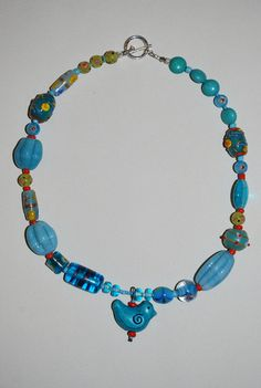 This little blue bird was found in the mountains of La Palma. The ceramic artist has a wheel set up outside under a fruit tree! Turquoise Necklace, Beaded Necklace, Ceramic Artists, Blue Bird, Ceramics, Mountains, Fruit, Jewelry, Design