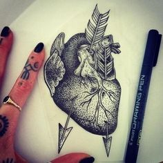 Anatomically correct heart tattoo with arrows.