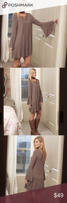 🌟Coming Soon!!🌟 Boho Bell Lace Up Dress Soft knit, non-clingy fabric with cute lace-up detail and bell sleeves. Made in USA.  • Sizes = S (2/4), M (6/8), L (10/12) • Color = Dark Taupe • Material = 95% Rayon, 5% Spandex • No offers for boutique items Dresses Long Sleeve