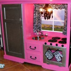 Old tv stand turned into a little kids kitchen :) could make a vanity/closet too