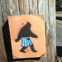 Mission Tartan Sasquatch.  Cedar and acrylic, street art, 2014.