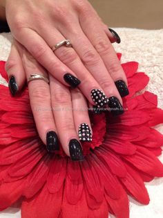 Black gel polish with Swarovski crystal nail art