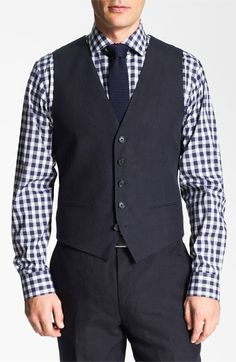 Navy linen vest and matching pants paired with silk knit tie and checkered shirt. Nice warm weather ensemble.