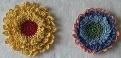 flower. crochet.  Here's the tutorial:  http://crochetchronicles.blogspot.com/2005/04/layered-dimensions-crochet-flower.html