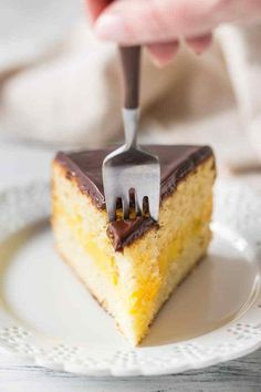 Homemade Boston Cream Pie from Scratch! With moist vanilla cake layers, sandwiched around a creamy custard filling, drizzled with a rich chocolate glaze. #bostoncreampie #recipe #fromscratch #homemade #filling #best #classic #custard #original #authentic #traditional #glutenfree #birthday #pudding #ganache #parkerhouse #frosting #desserts #video #oldfashioned #simple #topping #chocolate #icing #moist #vanilla #pastrycream #cremepatissiere