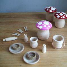oh how i love these wooden mushrooms using candle cups. great idea...and the painted tops as well! cute!