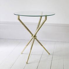 Unique contemporary side table.A stunning round tripod side table which has been intricately cast in aluminium with a gold finish and circular toughened glass top. The striking design would make a perfect addition to any sitting or living room. The circular glass top is the perfect size for a lamp and a favourite book.