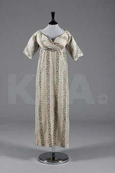 A printed muslin day dress, circa 1800-1810  This was not her era to look good. Poor lady.