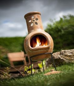 small clay chiminea flower decoration small patio fireplace ideas