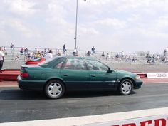 1995 Ford Taurus SHO (Super High Output). Powered by a powerful (at the time) 220 hp dohc factory placed Yamaha 6-cyl. This was the ultimate sleeper car and it would haul some serious ass. I've had two of them over the years. Would love to have a fully restored one again...