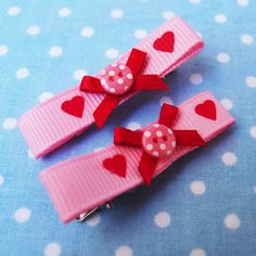 2 sweet love hair clips.  http://www.etsy.com/listing/90063579/valentine-hearts-pink-red-dots-button-2