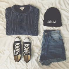 16. Dark charcoal gray cable knit sweater, Chuck Taylors, dark jean shorts, and a black beanie