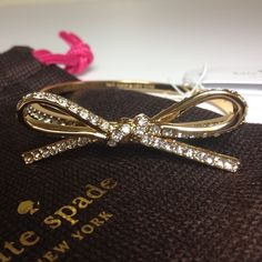 """NWT Kate Spade Pave Bow Bracelet - GOLD Gorgeous!  New with tags. Comes with dustbag as shown. Gold. Measures diameter of 2.25"""". Also available in Silver. NO TRADES kate spade Jewelry Bracelets"""