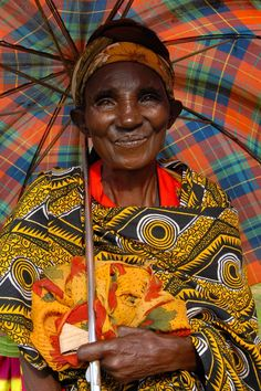 A Widow's Shelter: In parts of Burundi there is a custom: the only thing a woman takes with her to her new home when she marries, is her umbrella. And that umbrella may be all that she is left with in the end, thanks to another Burundi custom: a woman can be dispossessed of her home and farm when her husband dies. (Burundi, 2006) Photograph by Deborah Espinosa, senior attorney & land rights specialist at Landesa. Check out Landesa.org!