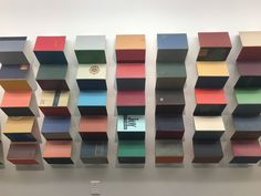 """Karen Kinney, """"Points of Departure,"""" 2017, vintage book covers on wood panels, at LAX airport"""