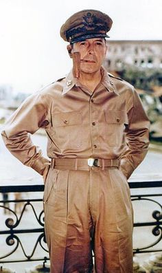 General of the Army Douglas MacArthur smoking his corncob pipe, probably at Manila, Philippine Islands, 2 August 1945.