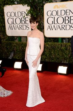 Anne Hathaway, in Chanel Haute Couture, with Chanel jewels.