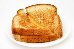 """125 Cal Grilled Cheese  *Two Slices of """"Sara Lee Honey Wheat Bread""""  *Fat Free """"I can't believe it's not butter""""  *Low Fat Kraft Single Cheddar Cheese"""