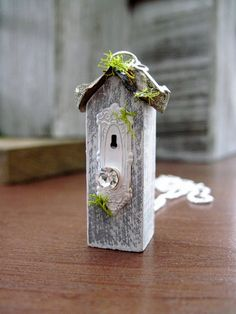 Mossy birdhouse necklace.
