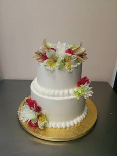 Two tier, white buttercream wedding cake with buttercream pearls and pink and white fresh flowers