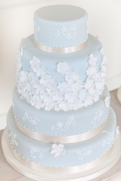 Light blue tiered wedding cake with satin ribbon and white embellishments   Soft Classic & Romantic Wedding Ideas via @whimwondwed, pics by McKenzie-Brown Photography