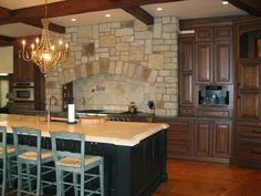 love the stone in this kitchen