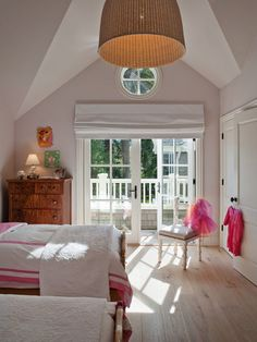 """""""We added the balcony to the girls' room to complement the master bedroom patio and to create an exterior architectural element over the breakfast nook,"""" says Heydt."""