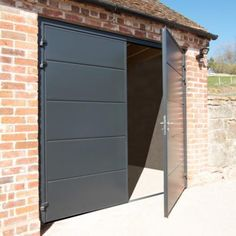 A side hinged door is a garage door which is firmly joined at each side with bi-parting door leafs which swing outwards onto your driveway. We offer a quality range of steel side hinged garage doors from The Garage Door Centre manufactured by Garador. Cheap Garage Doors, Grey Garage Doors, Side Hinged Garage Doors, Garage Door Hinges, Diy Garage Door, Garage Door Styles, Garage Door Makeover, Garage Door Design, Garage Office