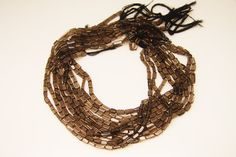 1strand  natural smoky quartz plain stick sized about 4 by by 3yes