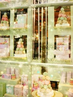 Paris Laduree Store  8x10 Mint Green and Peach Photo  by chezjolly, $22.00  So festive, it just makes me smile.  That, and well...it IS Paris!