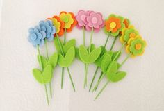 Set of 10pcs colorful wool felt flower with wood by ArtofSuppliers, $7.50
