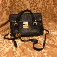 Black leather handbag  Beautiful black leather Michael Kors bag with gold details long straps and dust bag included. MICHAEL Michael Kors Bags