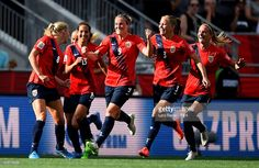 Solveig Gulbrandsen of Norway (L) celebrates with team mates after scoring her teams first goal during the FIFA Women's World Cup 2015 Round of 16 match between Norway and England at Lansdowne Stadium on June 22, 2015 in Ottawa, Canada.