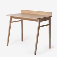 The Reader Desk is designed for writing, reading, working, and dreaming. The characteristic back ledge and groove prevents objects from falling behind your desk, while providing a most convenient plac
