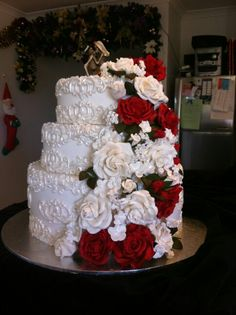 Wedding cake detailed scrolling and roses