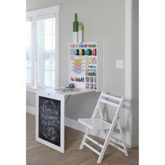 Folding craft table with space for storage.