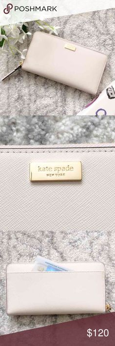 """Kate Spade Zip Wallet Kate Spade Neda Newbury Lane Zip Wallet   Color: Pebble   Fits your phone! Great for quick trips to the store!   Zip wallet clutch in a gorgeous neutral color!  Back slip pocket that fits your phone  Zip closure to keep things secure  Fully lined in a soft sateen with 14-karat gold plated hardware 12 credit card slots, a center zip pocket, 2 full length bill slip pockets,  2 large expandable pockets can easily hold a cell phone Measures: 8"""" (W) X 4""""(H) X 2""""(D) kate…"""