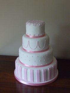 Pretty in Pink: 4 tier wedding cake with a combination of decoration styles.