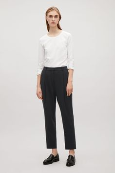 COS image 4 of Tailored pleat trousers in Black