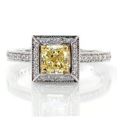 Framed in a perfect square, four 14k yellow gold prongs showcase a 0.75 carat fancy yellow radiant cut center diamond on Design 2041. Magnificent lines of milgrain outline round bright-cut and bead-set micro pavé diamonds that join the delicate 14k white gold band to the halo.  #engagement #wedding #ring www.knoxjewelers.biz