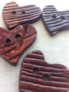 Handmade ceramic glazed red heart shaped button with wood grain texture by CraftyleftDee on Etsy https://www.etsy.com/listing/176946375/handmade-ceramic-glazed-red-heart-shaped