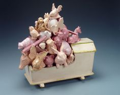 """wendy walgate The Very Pink of Perfection 18"""" H x 17"""" W x 11"""" D, 2007, white earthenware, slipcast, glazed, vintage wooden toy cradle"""