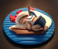 Fondant edible baby nautical sailor cake by evynisscaketopper