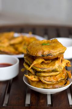 Baingan Pakoda Recipe, How to make Baingan Pakoda - Easy Baingan Pakoda recipe a tempting finger food snack. Due to sudden rains got tempted to make pakoras. As hubby loves baingan so made the pakoras for him. Brinjal or Aubergines are referred as baingan in India. They taste well with dry garlic chutney, green chutney, tomato sauce or chili sauce.