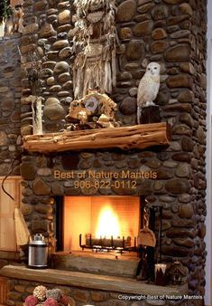 Couldn't you just picture a row of stockings hanging here at Christmas time? Or curling up by this fire with a favorite book? I like the look of the river rocks here.