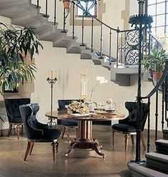 Love the concept of making the foyer large and using it for dining.  Too much $ is spent on a gorgeous staircase to only walk through the room.