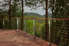 This home in the heart of Nashville boasts outstanding views of the mountains. The brushed stainless steel posts catch and reflect the glistening sun. Metal Stairs, Metal Railings, Staircase Railings, Stainless Steel Cable Railing, Brushed Stainless Steel, Stair Supplies, Deck Posts, Parts Of Stairs, House On A Hill