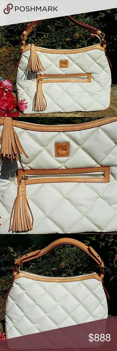 """Dooney & Bourke White Spicy Sac Never used. Chic white bag for spring and summer. 15"""" L x 11"""" H. 4 interior pockets. Red interior. Dooney & Bourke Bags Hobos"""